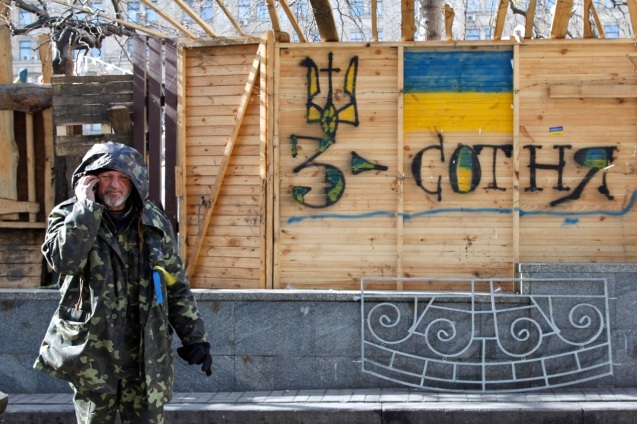 A feminine ribbon showing Ukrainian pride as tough citizen guard makes morning calls
