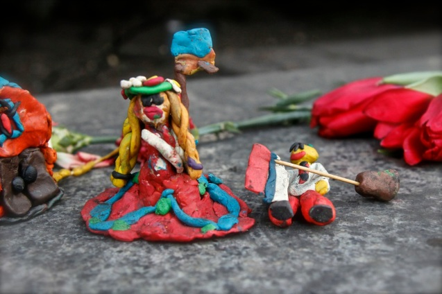 Clay models among the flowers depict Ukranians trumping the Russians