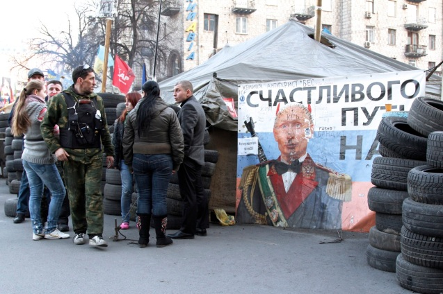 Crowd gathers around newly curated Putin graffiti in the run up to referendum vote in Crimea